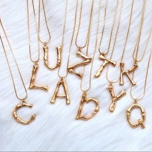 Letter M in gold